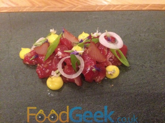Raw ox in coal oil, assorted onions, hyssop, mustard mayo