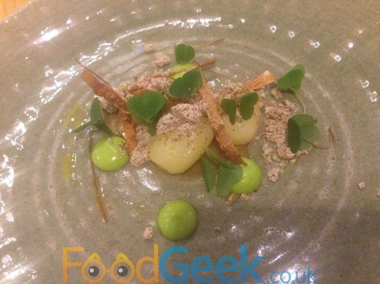 Heritage potatoes in onion ashes, lovage, shallot, wood sorrel